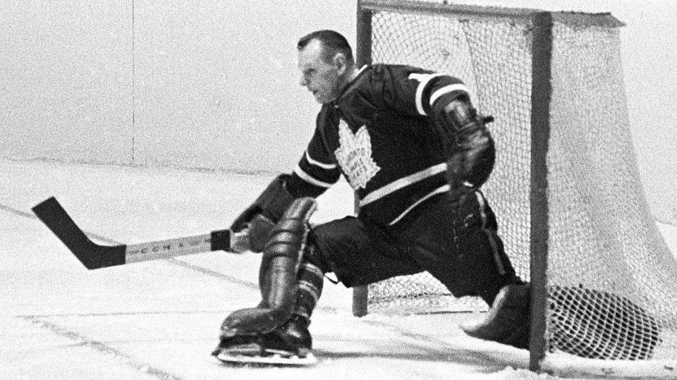 Toronto Maple Leafs' Johnny Bower makes a kick save during a playoff action against The Montreal Canadiens in Montreal in 1966. Canadian hockey legend Johnny Bower has died. A statement from his family says the 93-year-old died after a short battle with pneumonia. THE CANADIAN PRESS
