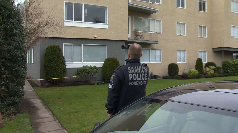 Investigators spent Boxing Day documenting the scene at an Oak Bay apartment where two children were found dead and a man was found injured.