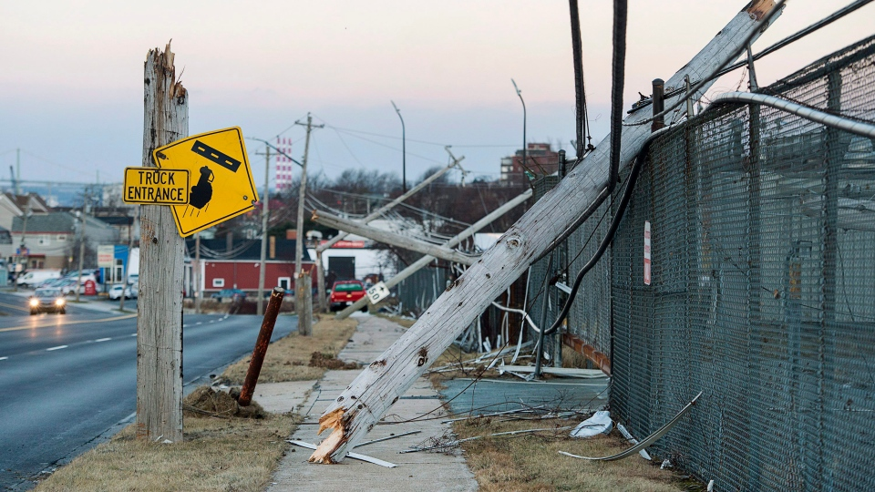 Damaged power lines are seen in Dartmouth, N.S., on Tuesday, Dec. 26, 2017. Thousands of Nova Scotia Power customers are without electricity after a Christmas Day windstorm wreaked havoc across the province, interrupting dinners and disrupting travel. (THE CANADIAN PRESS / Andrew Vaughan)