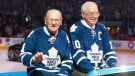 Former Maple Leafs Johnny Bower, left, and George Armstrong are paraded around the ice at the 50th anniversary of the team's 1963 Stanley Cup victory ahead of the Toronto Maple Leafs game against the Ottawa Senators in Toronto on February 16, 2013. (THE CANADIAN PRESS / Chris Young)