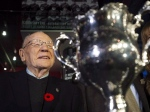 Canadian Second World War veteran and hockey hall of fame inductee Johnny Bower is seen next to the Memorial Cup as he takes part in a new exhibit dedicated to First World War and Second World War veterans at the Hockey Hall of Fame in Toronto on November 10, 2014. (THE CANADIAN PRESS / Nathan Denette)