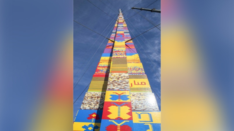 A LEGO tower under construction in Tel Aviv's Rabin Square, as the city attempts to break the Guinness World Record for the highest such structure. JACK GUEZ / AFP