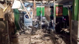 This photo provided by the Information Center of the Russian National Antiterrorism Committee shows the damage inside a supermarket after an explosion, in St. Petersburg, Russia, Thursday, Dec. 28, 2017. (National Antiterrorism Committee via AP)