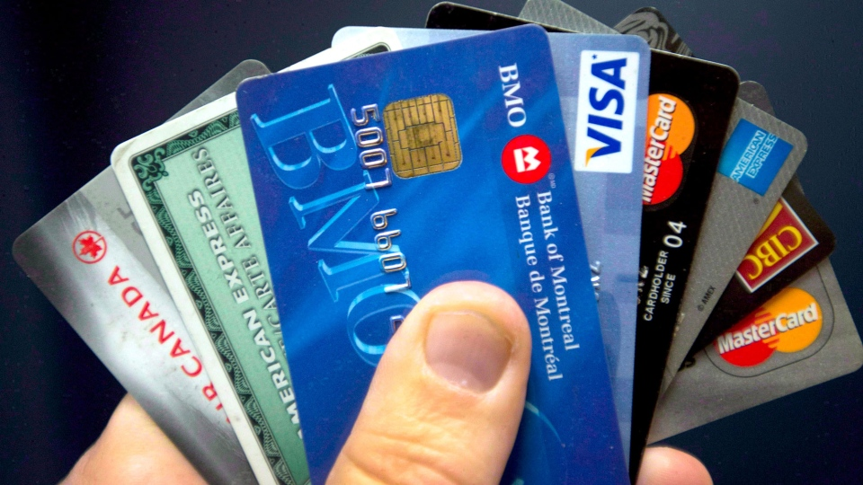 A new survey by the Canadian Payroll Association says fewer Canadians are living paycheque to paycheque but more are overwhelmed by debt. (File)