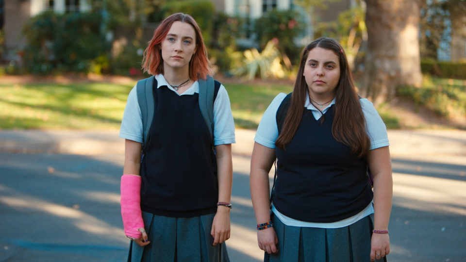 "This file image released by A24 Films shows Saoirse Ronan, left, and Beanie Feldstein in a scene from ""Lady Bird."" (Merie Wallace/A24 via AP, File)"