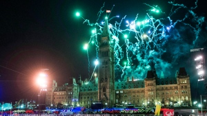 Fireworks explode above Centre Block's Peace Tower during the illumination launch ceremony of Christmas Lights Across Canada on Parliament Hill in Ottawa on Dec. 7, 2017. (THE CANADIAN PRESS/Justin Tang)