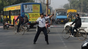 Indian traffic policeman Ranjeet Singh is inspired by Bollywood and has a Freddie Mercury-style moustache -- but it is his Michael Jackson dance moves that grab attention on the chaotic streets of Indore. (Indranil Mukherjee/AFP)