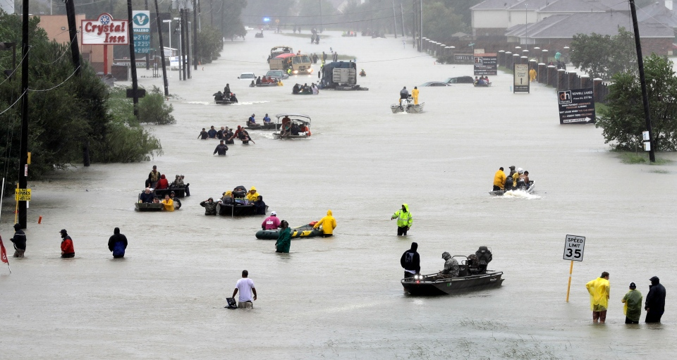 Rescue boats float on a flooded street as people are evacuated from rising floodwaters brought on by Tropical Storm Harvey on Aug. 28, 2017, in Houston. (AP Photo/David J. Phillip)