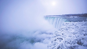 Mist rises above the brink of the Horseshoe Falls in Niagara Falls, Ont., as cold weather continues through much of the province on Friday, December 29, 2017. THE CANADIAN PRESS/Aaron Lynett