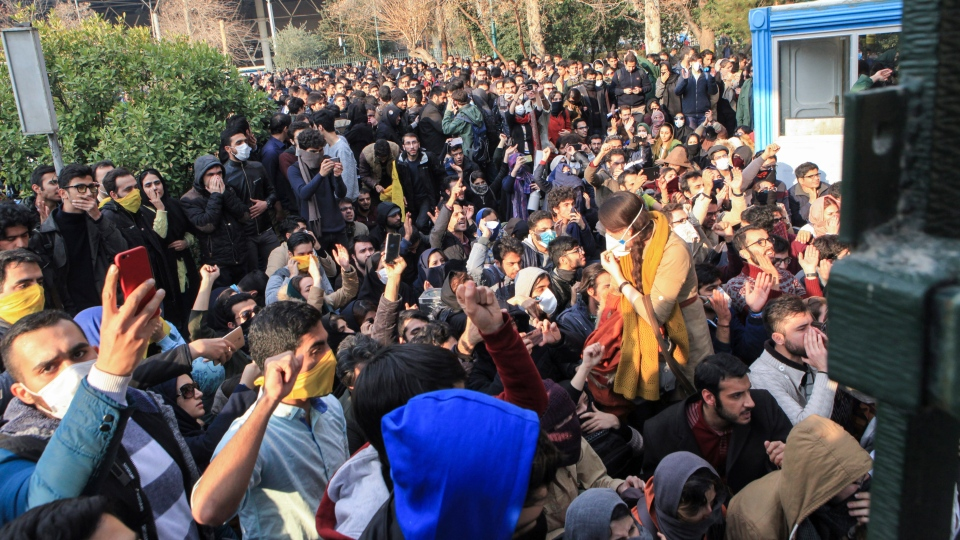 In this photo taken by an individual not employed by the Associated Press and obtained by the AP outside Iran, university students attend a protest inside Tehran University while anti-riot Iranian police prevent them to join other protestors, in Tehran, Iran, Saturday, Dec. 30, 2017. (AP Photo)