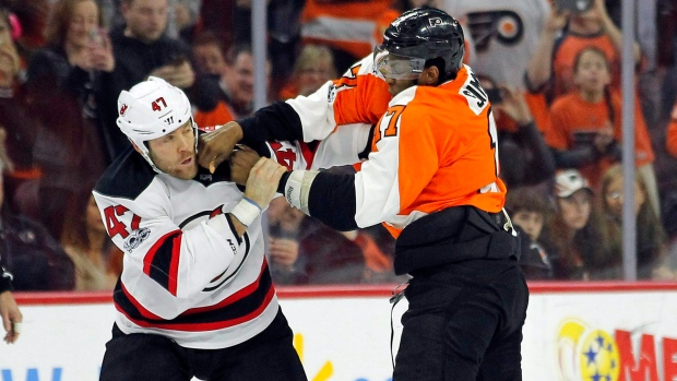New Jersey Devils' Dalton Prout, left, and Philadelphia Flyers' Wayne Simmonds fight during the second period of an NHL hockey game, in Philadelphia, on Saturday, April 1, 2017. (AP Photo/Tom Mihalek)