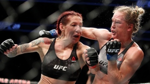Holly Holm, right, fights Cris Cyborg during a featherweight championship mixed martial arts bout at UFC 219, Saturday, Dec. 30, 2017, in Las Vegas. (AP / John Locher)