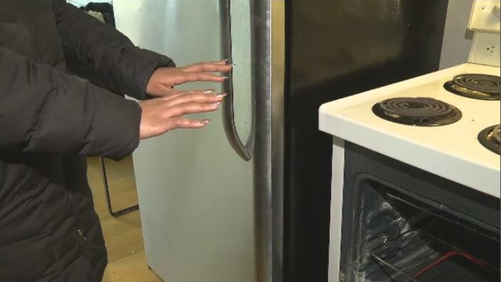 An Edmonton resident named Aliyah is using her stove to keep warm while awaiting repairs to a crucial heating unit in her condo building. (CTV Edmonton)
