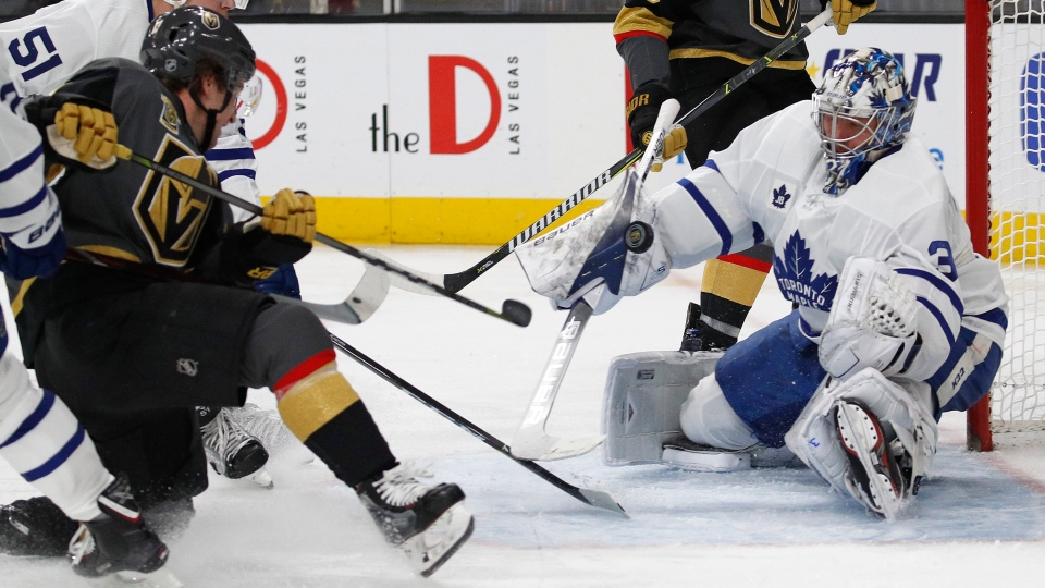 Toronto Maple Leafs goaltender Frederik Andersen blocks a shot by Vegas Golden Knights left wing Brendan Leipsic, left, during the second period of an NHL hockey game, Sunday, Dec. 31, 2017, in Las Vegas. (AP Photo / John Locher)