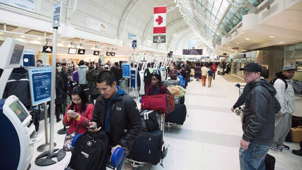 Passengers in line at Toronto's Pearson Airport