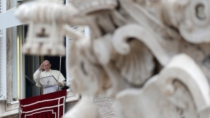 Pope Francis salutes the faithful as he recites the first Angelus prayer of the new year from his studio overlooking St. Peter's square at the Vatican, Monday, Jan. 1, 2018. (AP Photo/Andrew Medichini)