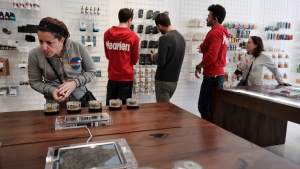 In this Dec. 21, 2017, file photo, a customer browses a selection of marijuana products displayed at MedMen a marijuana dispensary in Los Angeles .(AP / Richard Vogel, File)