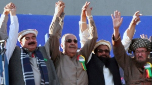 In this Friday, Dec. 29, 2017, photo, Palestinian Ambassador to Pakistan Walid Abu Ali, second left, raises jointly hands with Hafiz Saeed, second right, the head of the hard-line Jamaat-ud-Dawa, and others during an anti-U.S. rally in Rawalpindi, Pakistan. (AP / A.H. Chaudary)