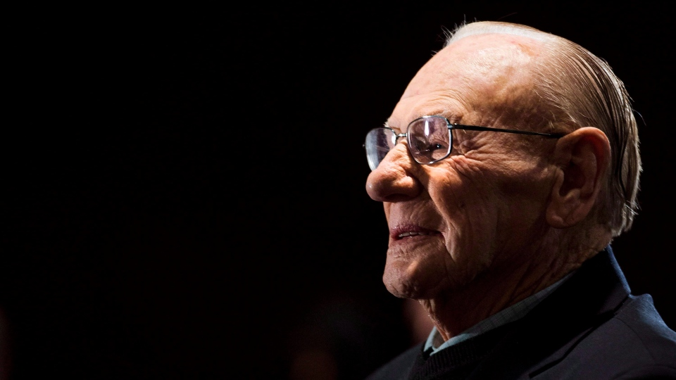 Canadian Second World War veteran and hockey hall of fame inductee Johnny Bower takes part in ceremony showing the new exhibit dedicated to First World War and Second World War veterans at the Hockey Hall of Fame in Toronto on November 10, 2014. (THE CANADIAN PRESS/Nathan Denette)