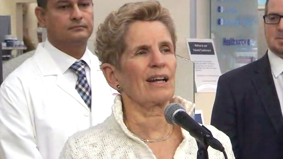 Ontario Premier Kathleen Wynne speaks to reporters at a Toronto pharmacy on Tuesday, Jan. 2, 2017.