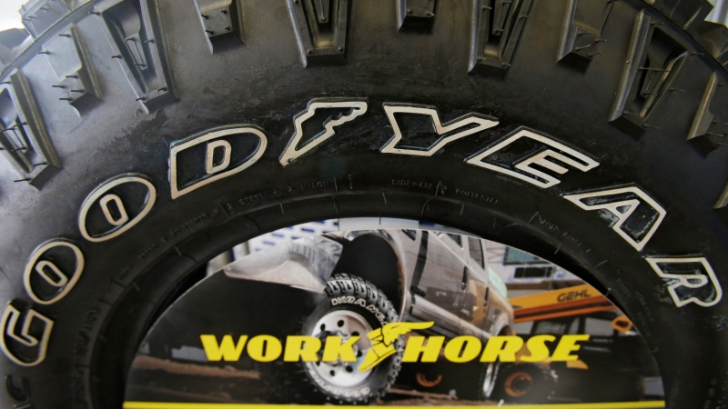 This Wednesday, Feb. 12, 2014, file photo shows a Goodyear tire on display at a tire shop in South Euclid, Ohio. (AP Photo/Tony Dejak, File)