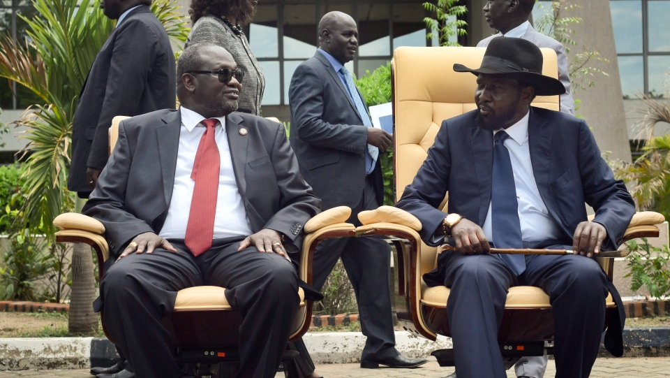 FILE -- South Sudan's First Vice President Riek Machar, left, looks across at President Salva Kiir, right, following the first meeting of a new transitional coalition government, in the capital Juba, South Sudan, on Friday, April 29, 2016. (AP Photo/Jason Patinkin)
