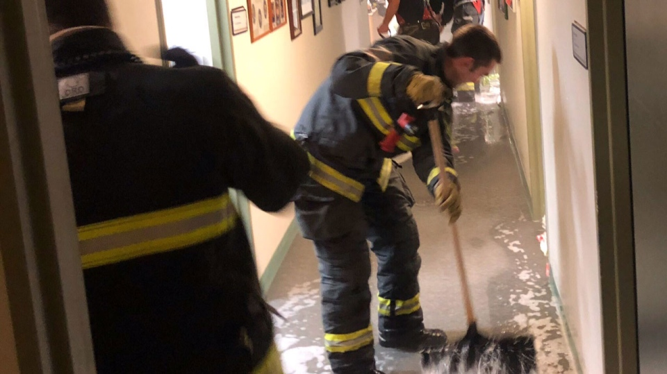 Firefighters responding to St. Amant burst pipe on New Year's Day. (Source: Twitter/@UFFW867)