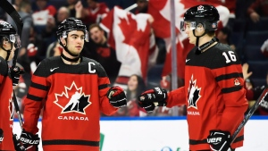 Canada's Dillon Dube, left, celebrates a goal against Switzerland with Taylor Raddysh (16) during third period quarter-final IIHF World Junior Championships hockey action in Buffalo, N.Y. on Tuesday, January 2, 2018. THE CANADIAN PRESS/Nathan Denette