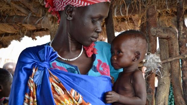 Elizabeth Nyakoda holds her baby