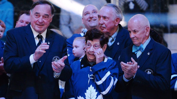 Nancy Bower, wife of the late NHL great Johnny Bower, watches a tribute to her husband with former Toronto Maple Leafs players Frank Mahovlich, left, and Dave Keon prior to NHL hockey action, between the Tampa Bay Lightning and Toronto Maple Leafs in Toronto on Tuesday, January 2, 2018. THE CANADIAN PRESS/Frank Gunn