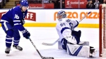 Tampa Bay Lightning goaltender Andrei Vasilevskiy (88) makes a save on Toronto Maple Leafs centre Mitchell Marner (16) during second period NHL hockey action in Toronto on Tuesday, January 2, 2018. THE CANADIAN PRESS/Frank Gunn