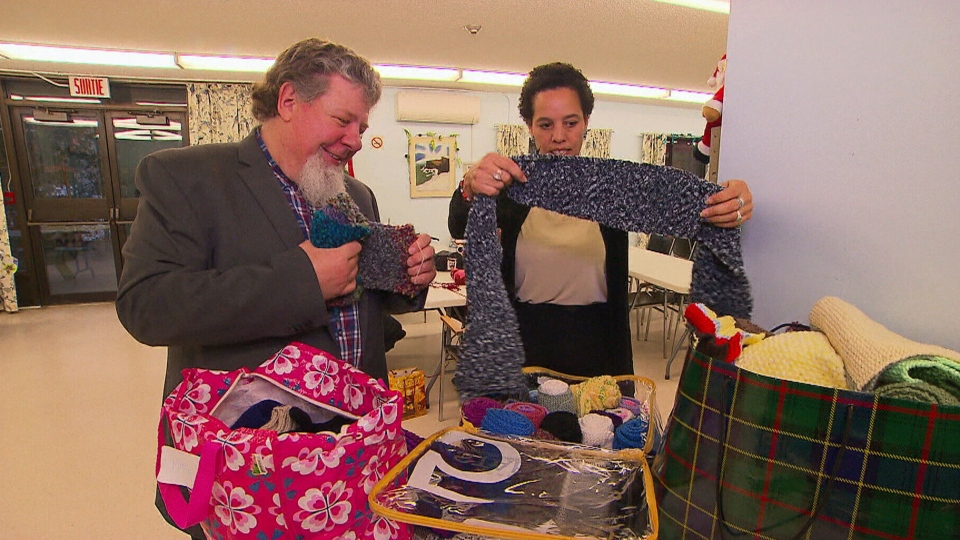 Gilles Chiasson, left, founded a group that knits winter clothing for the homeless.