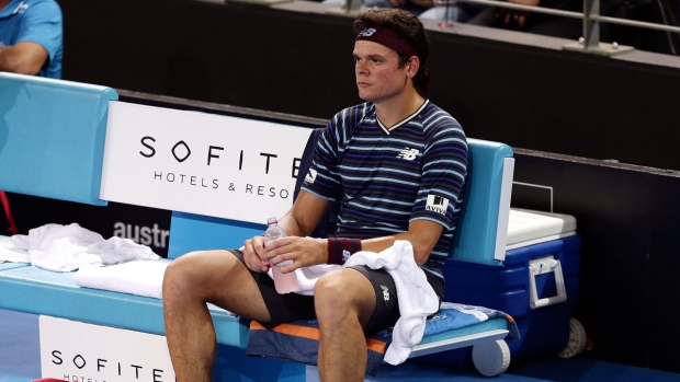 Milos Raonic looks dejected after a loss