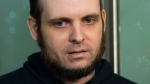 Joshua Boyle speaks to the media after arriving at the Pearson International Airport in Toronto, Oct. 31, 2017. (Nathan Denette / The Canadian Press via AP)