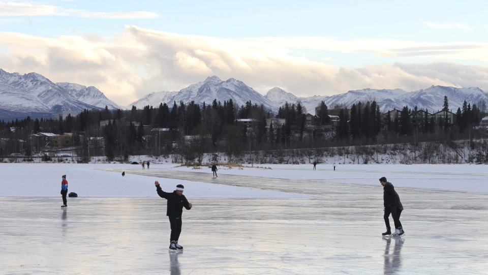 In this Jan. 2, 2018, file photo, ice skaters take advantage of unseasonable warm temperatures to ice skate outside at Westchester Lagoon in Anchorage, Alaska. (AP Photo/Mark Thiessen, File)
