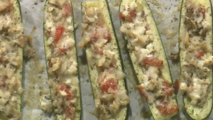 Zucchini boats with sauteed mushrooms and cheese