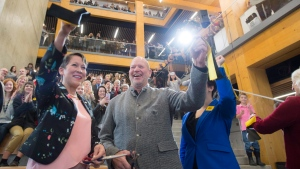 Chip Wilson, right, and Advanced Education Minister Melanie Mark hold up a ribbon they had just cut to open the Wilson School of Design at Kwantlen Polytechnic University in Richmond, B.C. on Wednesday, Jan. 3, 2018. (THE CANADIAN PRESS/Jonathan Hayward)