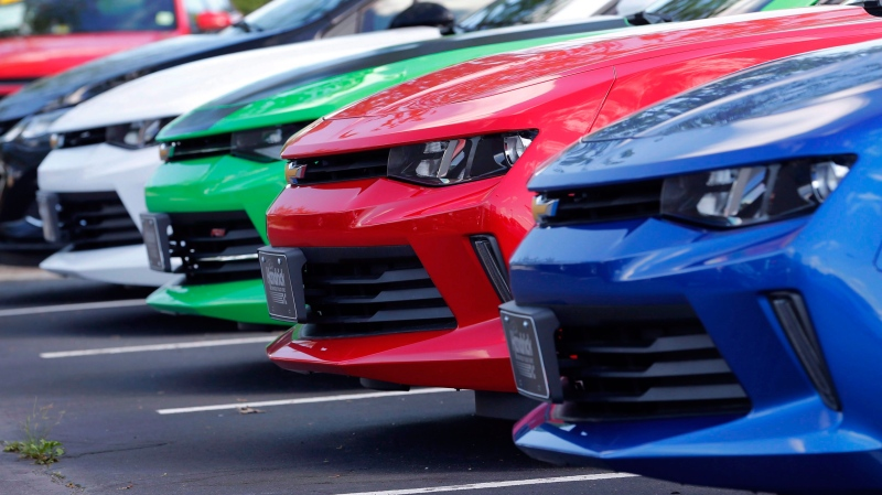 In this Wednesday, April 26, 2017, photo, cars are lined up in the lot of a Chevrolet dealership in Richmond, Va. THE CANADIAN PRESS/AP-Steve Helber