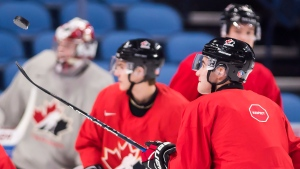 Canada captain Dillon Dube (9) flips the puck around during practice ahead of the upcoming semi-final IIHF World Junior Championships, against the Czech Republic in Buffalo, N.Y., on Wednesday, January 3, 2018. (Nathan Denette/THE CANADIAN PRESS)
