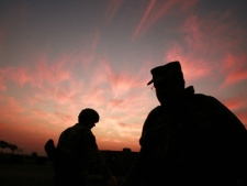 The sun sets at a U.S. military base Camp Liberty in Baghdad, Iraq Thursday, Jan. 25, 2007. (AP / Maya Alleruzzo)
