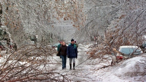 Pedestrians make their way past downed trees as an ice storm ripped through Montreal Tuesday, January 6, 1998. (THE CANADIAN PRESS/Ryan Remiorz)