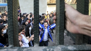 University students attend an anti-government protest inside Tehran University, in Tehran, Iran, on Dec. 30, 2017. (AP)
