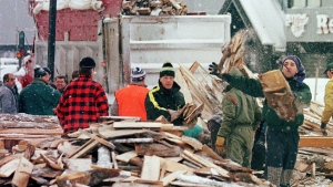 FILE -- Volunteers in Quebec City pile firewood to be sent to the Montreal region after an ice storm, on Jan. 13, 1998. (THE CANADIAN PRESS/ Jacques Boissinot)