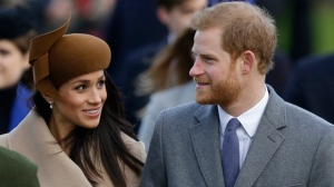 FILE - This is a Monday, Dec. 25, 2017. file photo of Britain's Prince Harry and his fiancee Meghan Markle as they arrive to attend the traditional Christmas Day service, at St. Mary Magdalene Church in Sandringham, England. A political storm is brewing ahead of Prince Harry's and Meghan Markle's May 19 wedding over whether to crack down on homeless people and beggars in the well-to-do English town of Windsor. (AP Photo/Alastair Grant/File)