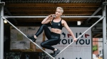 This Oct. 26, 2017 photo shows Bethany C. Meyers in New York City, where she uses the urban landscape for workouts. (Victoria Matthews/Bethany C. Meyers via AP)