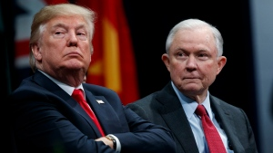 In this Dec. 15, 2017, file photo, U.S. President Donald Trump sits with Attorney General Jeff Sessions during the FBI National Academy graduation ceremony in Quantico, Va. (Evan Vucci/AP Photo)