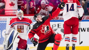 Canada forward Drake Batherson (19) celebrates after scoring against Czech Republic goaltender Josef Korenar (30) during the second period semifinal IIHF World Junior Championships hockey action in Buffalo, N.Y., on Thursday, Jan. 4, 2018. (Nathan Denette/THE CANADIAN PRESS)