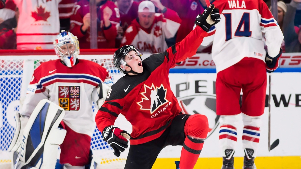 Canada forward Drake Batherson (19) celebrates after scoring against Czech  Republic goaltender Josef Korenar (30) during the second period semifinal  IIHF ... d52d21ba691