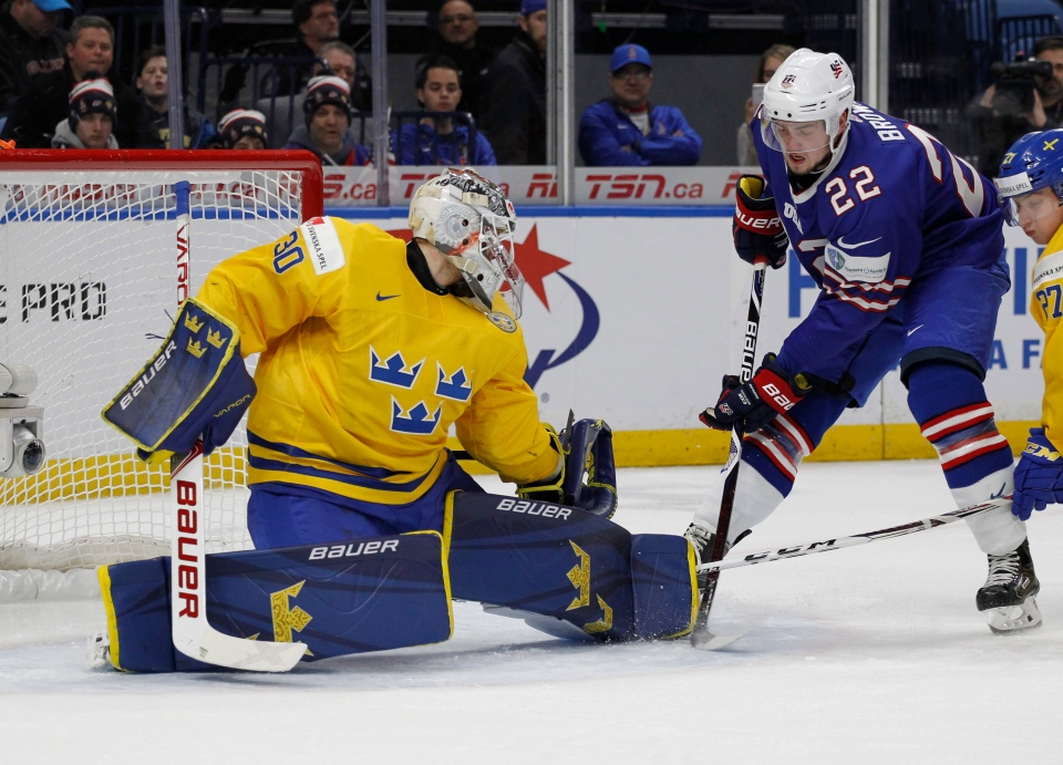 United States forward Logan Brown (22) is stopped by Sweden goalie Filip Gustavsson (30) during the first period of a semifinal game at the world junior hockey championship in Buffalo, N.Y., Thursday, Jan. 4, 2018. (Jeffrey T. Barnes/AP Photo)