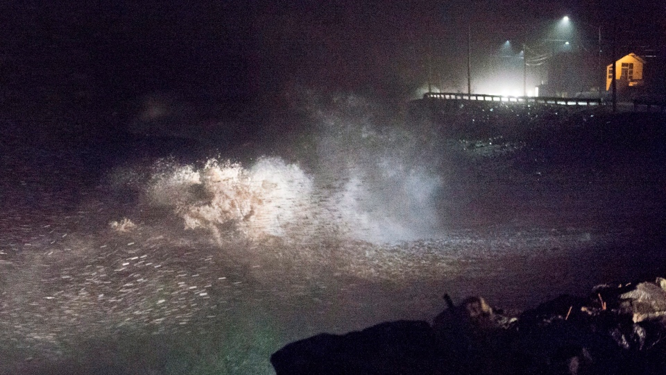 Waves pound the shore in Eastern Passage, N.S. on Thursday, Jan. 4, 2018. Environment Canada has issued winter storm warnings and watches for Nova Scotia, New Brunswick, P.E.I. and parts of Newfoundland and Labrador, as a low-pressure system brings fierce winds, rain and heavy snow in places. (THE CANADIAN PRESS/Andrew Vaughan)